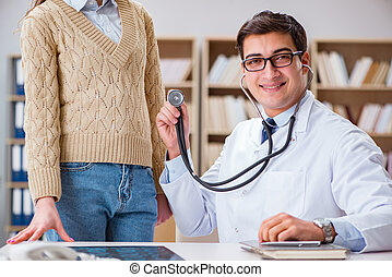 Young doctor examining patient with stethoscope