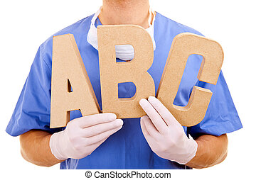 Young doctor holding letters a b c