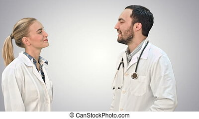 Young doctor joking on his collegue not give five on white...
