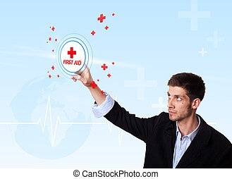 Young doctor pressing first aid button
