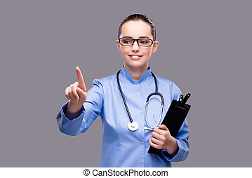 Young doctor pressing virtual button