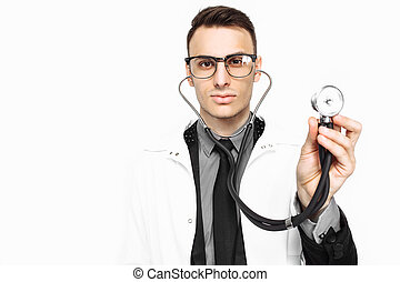 Young doctor showing a stethoscope to the survey. Close-up, hand holding a stethoscope to check breathing. isolated on white background