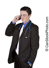 Young doctor talking on a cell phone - Isolated businessman...