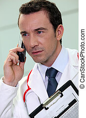 young doctor talking on his cell phone