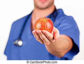 Young doctor with an apple
