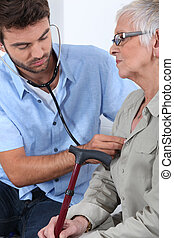 Young doctor with elderly patient
