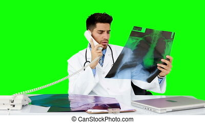 Young doctor working at his desk