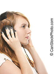 young dreamy redhead woman listening to music with her headphones on white background