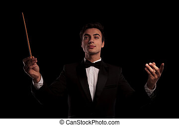 young elegant conductor directing his orchestra band