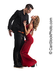 Young elegant couple dancing, isolated on white