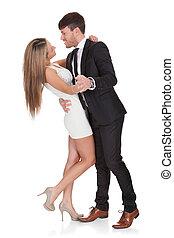 Young elegant couple dancing