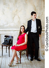 Young elegant couple waiting a baby