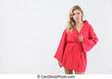 young elegant woman in red dress on white. Fashion studio shot