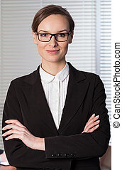 Young elegant woman working in office
