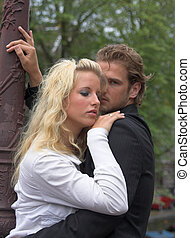 Young embracing adult couple - Young adult couple embracing ...