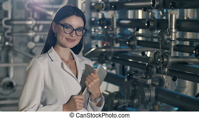 Young employee at the factory - Portrait of a beutiful woman...
