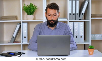 young employee finalizing project at workplace