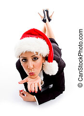 young employee with christmas hat giving flying kiss against...