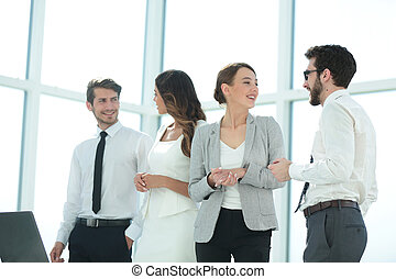 young employees talk in the office