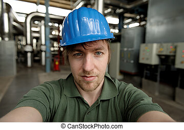 Young engineer in a power plant