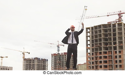Young engineer makes a selfie at the construction site