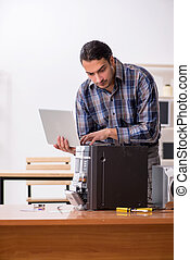Young engineer repairing musical hi-fi system - The young ...