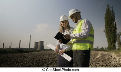 Young engineer technician offering helpful assistance to...