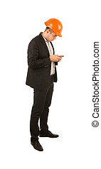 Young engineer using his mobile phone to text