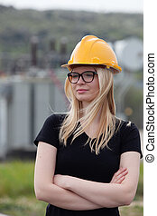 Young engineer with yellow helmet