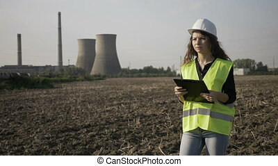 Young engineer woman in charge with work safety inspecting...