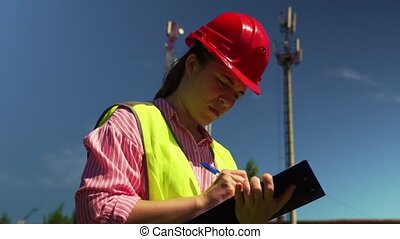 Woman Signs A Contract For The Construction - Young Engineer...