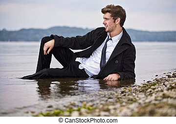concept of young businessman or entrepreneur getting their feet wet