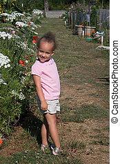 Young Ethnic Girl in Garden