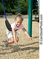 Young Ethnic Girl in Swing