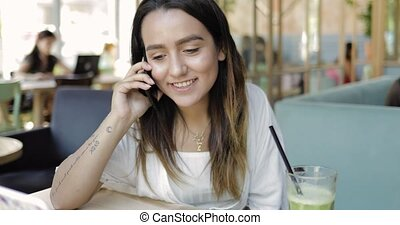 Young ethnic woman using mobile phone