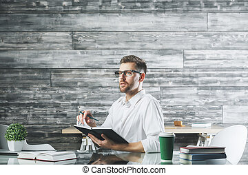 Young european businessman at workplace