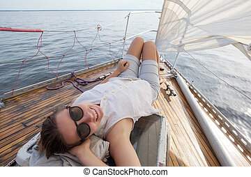 young european woman on deck of yacht.