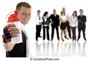 young excersier with a shaker bottle and professional young people in the background