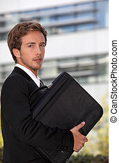 Young executive with a briefcase