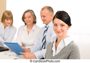 Young executive woman look camera during meeting