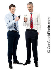 Young executives using mobile phone