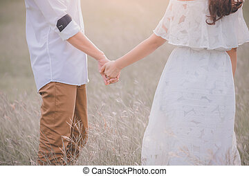 Young express love with a handshake as a symbol of love