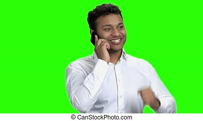Young expressive businessman talking on phone.