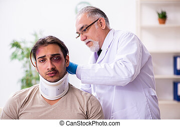 Young face injured man visiting experienced male doctor traumatologist