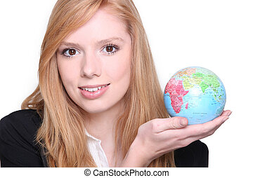 Young fair-haired woman carrying globe