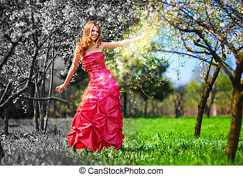 Young fairy woman in red dress