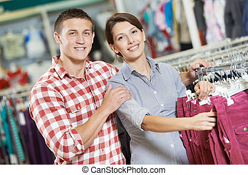 Young family at clothes shopping store