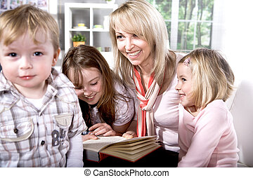 family at reading in the flat