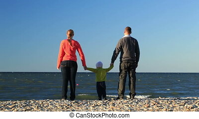 Young family at the seaside