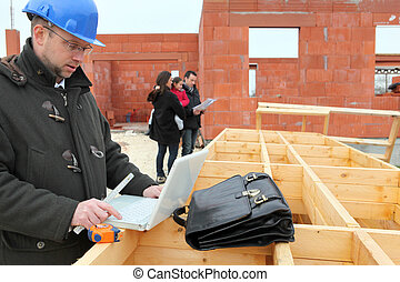 Young family being shown around site of new house